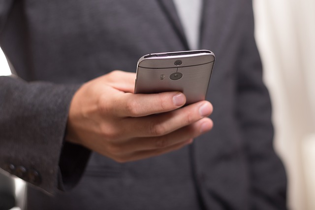 man using a mobile phone